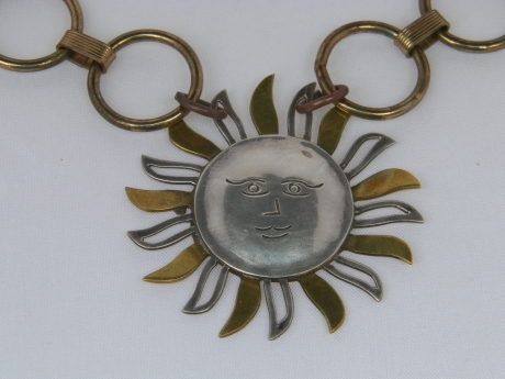 Sunburst Necklace - Silver and copper sunburst (2 inches).  Chain is a 60