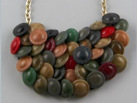 24in. Plastic Button Necklace - Goldtone chain with various early plastic buttons hand sewn on metal base.  23""