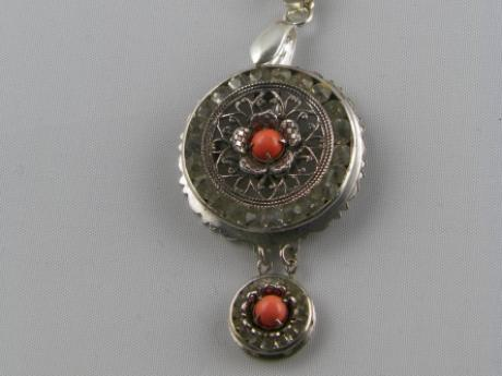 Coral/Rhinestone Necklace - Silver rhinestone pendant with coral centers and coral vintage chain. 26""